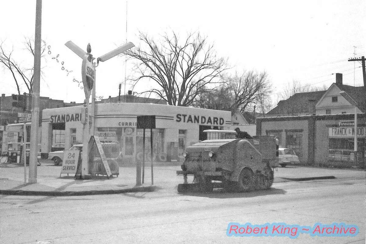 Currie's Standard gas station once stood at the corner of State Street and maple Street where Family Video is now. The station was demolished by Standard Oil Company after Currie moved his business to the current location on East Maple Street. (Photo courtesy of Robert King)