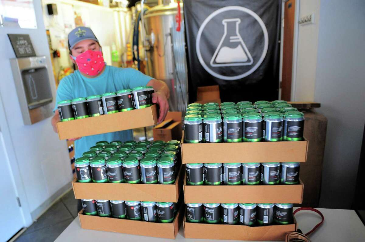 """Aspetuck Brew Lab employees Ryan Orvis works at the brewery in Bridgeport. For those that do remain open - as many featured on the state's tourist-facing Connecticut Beer Trail have - operating in a pandemic has meant flexibility of space, strict seating rules, and partnerships with food trucks and caterers to keep the kegs tapped. """"We could easily choose to be frustrated by the regulation and COVID overall - and believe me we have been - but being forced in a box, the most creative ideas emerge and action is required,"""" said Hog River Brewing Company's co-owner, Joy Braddock. Operators say they remain hopeful these adaptations, as well as a host of new releases and to-go offerings, will be enough for the businesses to stay afloat until restrictions are eased. Here's a look at where to sip some locally brewed suds and some of their newest offerings:"""