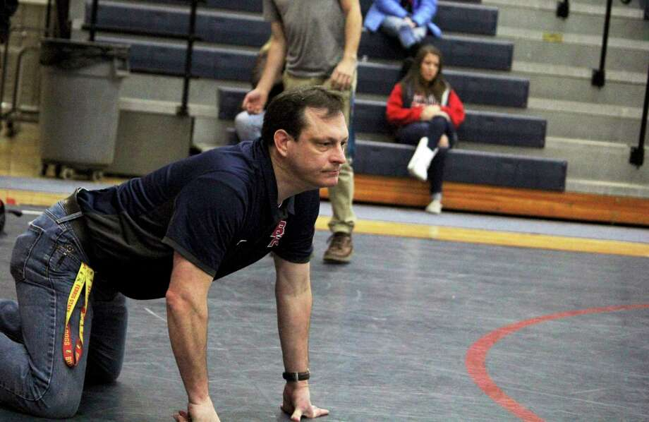 Big Rapids wrestling coach Bruce Hoffman closely follows the action during a competition last season. (Pioneer file photo)
