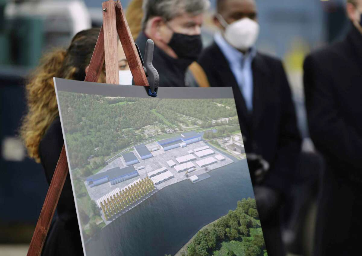 An artists rendition of what the proposed wind tower manufacturing facility could look like is seen on display at a press conference at the port on Thursday, Jan. 14, 2021, in Albany, N.Y. (Paul Buckowski/Times Union)