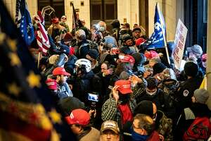 A pro-Trump mob storm the Capitol in Washington, Wednesday, Jan. 6, 2021. Trump loyalists earned money by broadcasting their storming of the Capitol on a streaming site called Dlive, which is benefiting from the growing exodus of right-wing users from Twitter, Facebook and YouTube. (Erin Schaff/The New York Times)