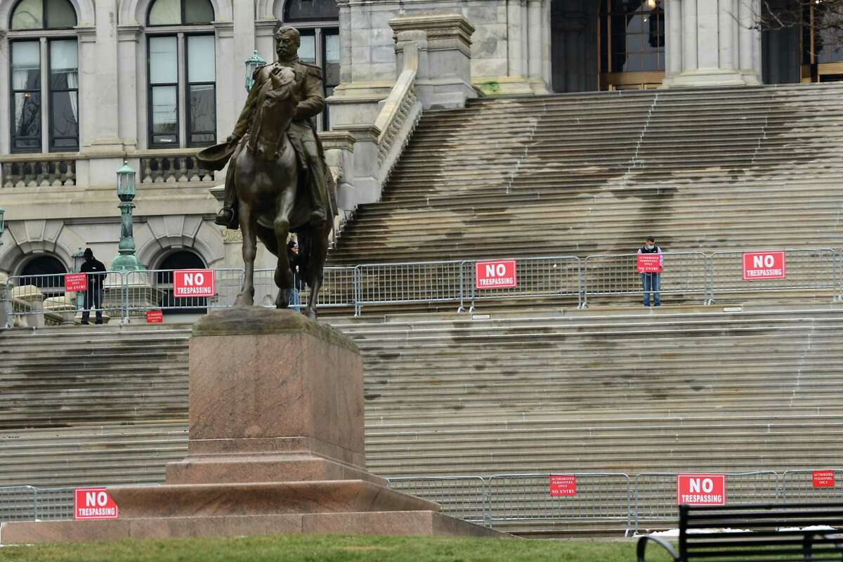 No trespassing signs are attached to metal barriers on the east stairs of the New York State Capitol on Thursday, Jan. 14, 2021 in Albany, N.Y. (Lori Van Buren/Times Union)