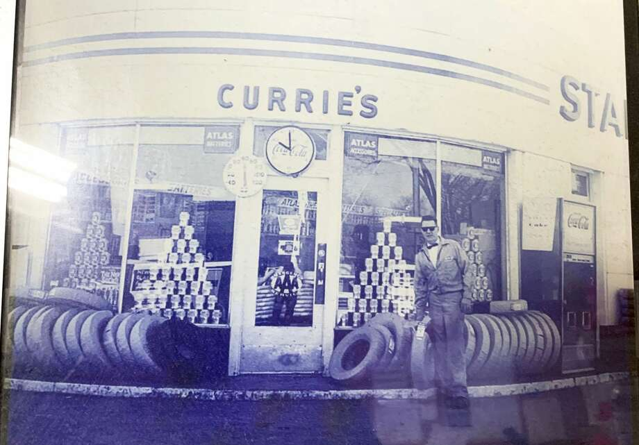 Richard Currie stands outside his Standard gas station once located on the corner of State Street and Maple Street, where the Family Video store is now located. Currie moved his operations to the location on East Maple in 1978. Photo: Photo Courtesy Of Pat Currie