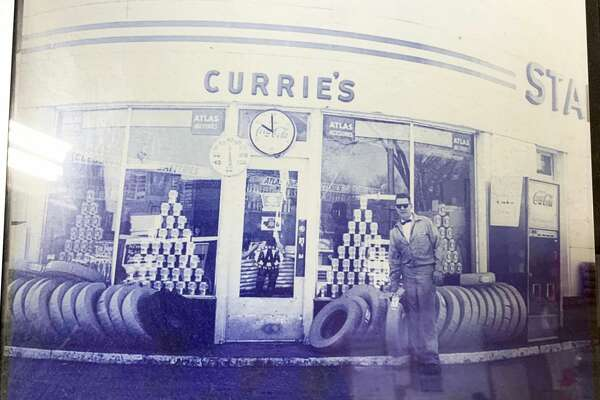 Richard Currie stands outside his Standard gas station once located on the corner of State Street and Maple Street, where the Family Video store is now located. Currie moved his operations to the location on East Maple in 1978.