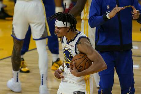 Golden State Warriors guard Damion Lee celebrates after the Warriors defeated the Toronto Raptors in an NBA basketball game in San Francisco, Sunday, Jan. 10, 2021. (AP Photo/Jeff Chiu)