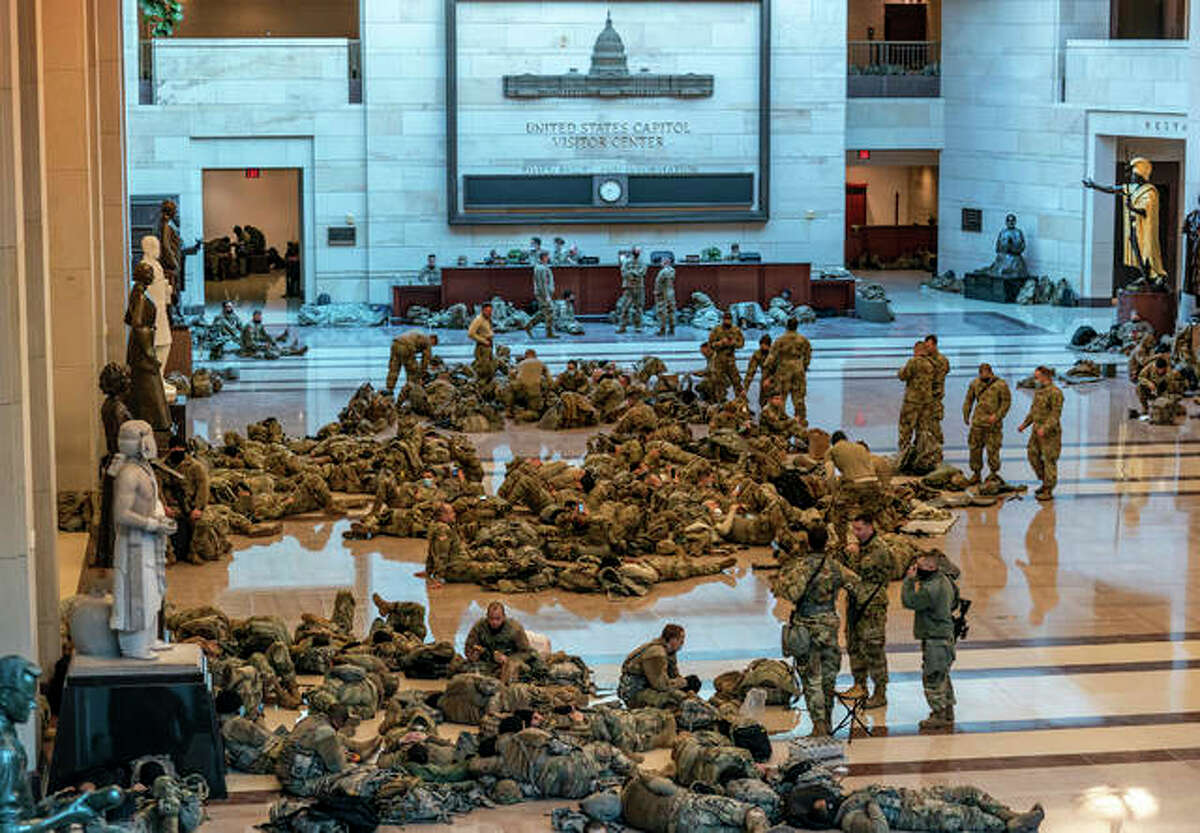 Hundreds of National Guard troops hold inside the Capitol Visitor's Center to reinforce security at the Capitol in Washington, Wednesday, Jan. 13, 2021. The House of Representatives pursued an article of impeachment against President Donald Trump for his role in inciting an angry mob to storm the Capitol last week.