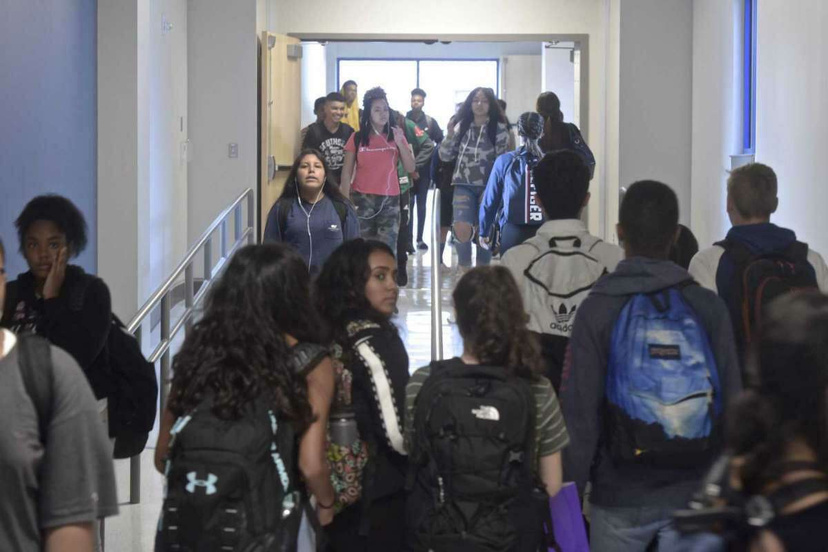 File photo: Students fill the hallway of the new addition at Danbury High School between classes on Wednesday, October 10, 2018.