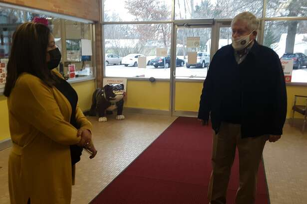 Windover High School Principal Marcella Mosqueda, left, talks with Kiwassee Kiwanis Foundation President Bruce Rayce at the school this week. The foundation presented a check for almost $10,00 to the school to meet needs caused by last year's flooding in May.