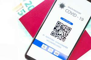 a series of photos showing a mobile application with a QR code showing a health passport for covid-19