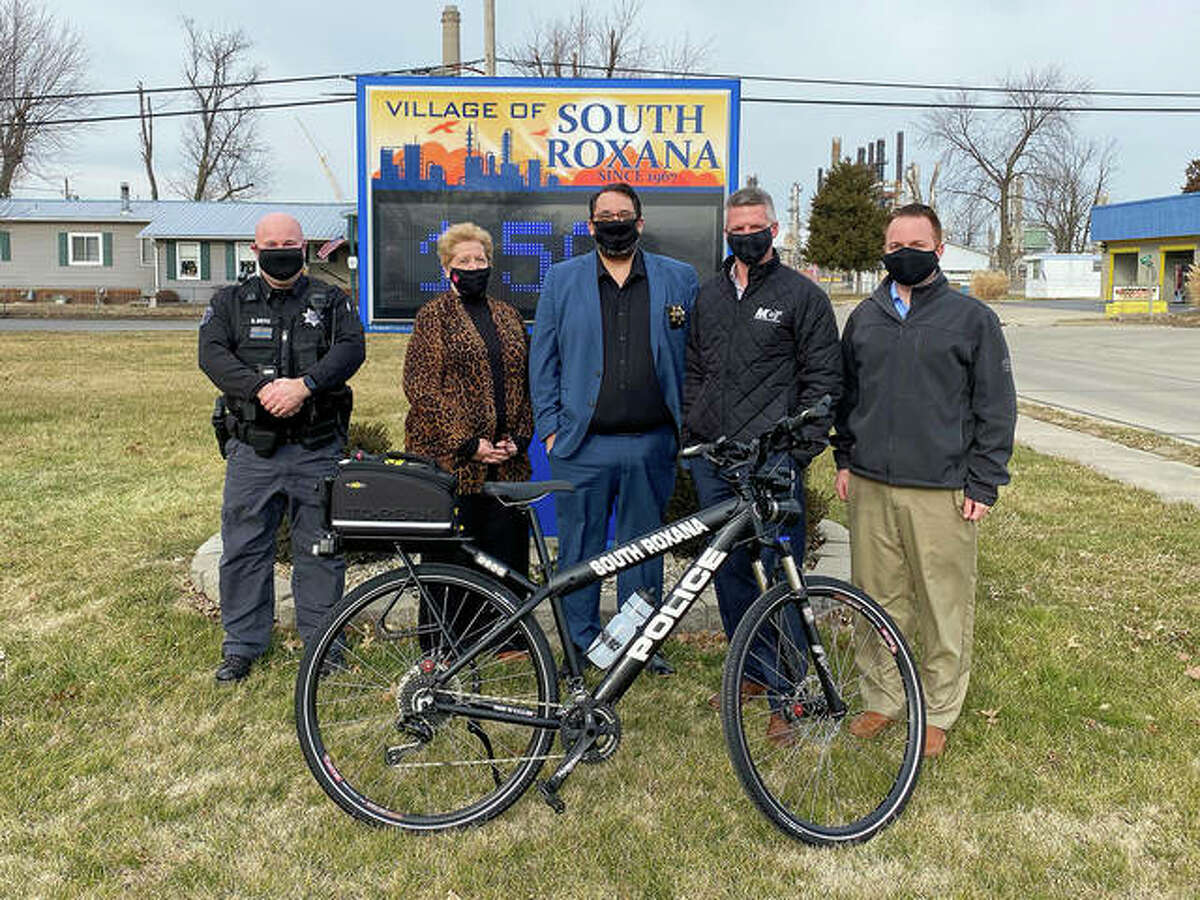 From left are South Roxana Police Lieutenant Brian Doyle, South Roxana Mayor Barb Overton, South Roxana Police Chief Bob Coles, MCT Managing Director SJ Morrison and MCT GIS Specialist David Cobb.
