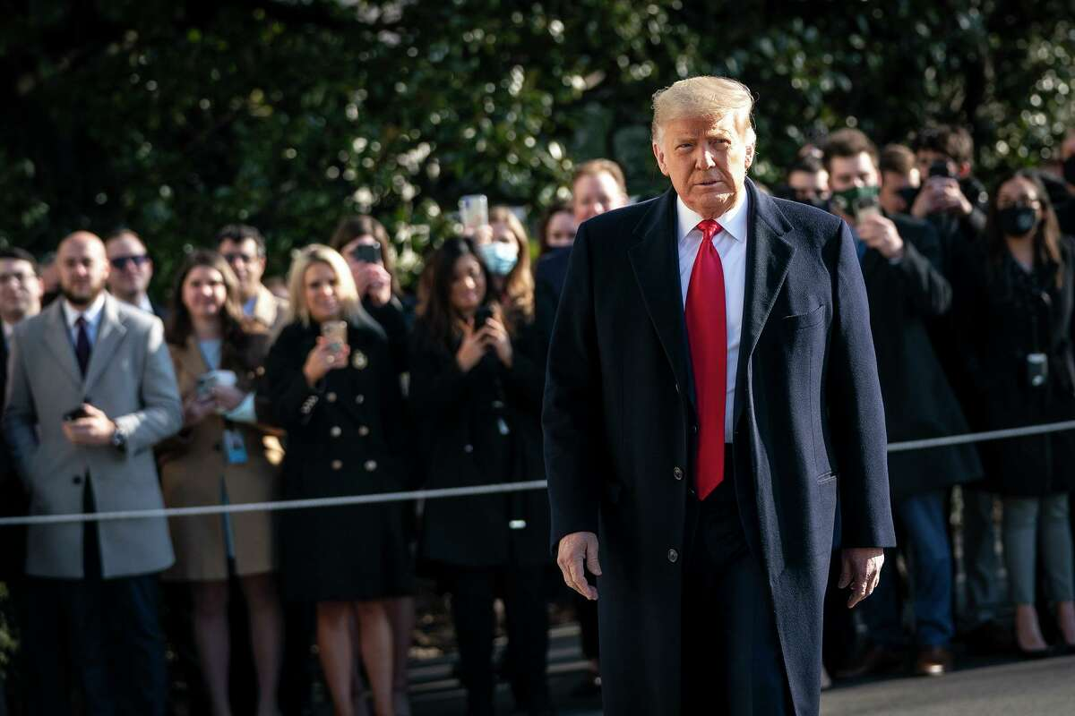U.S. President Donald Trump turns to reporters as he exits the White House to walk toward Marine One on the South Lawn on Jan. 12, 2021 in Washington, D.C. (Drew Angerer/Getty Images/TNS)