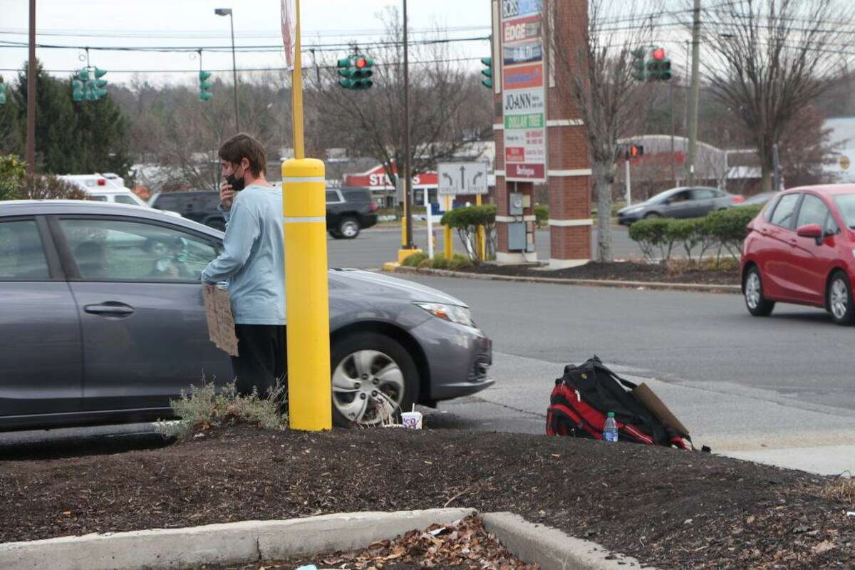 """A panhandler in Hamden to declined to give his name but said he is """"not from the area."""""""