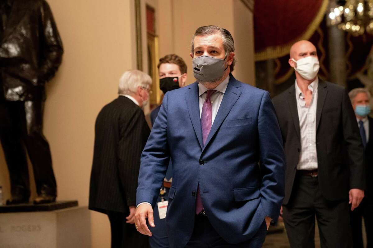 Senator Ted Cruz, a Republican from Texas, walks through the U.S. Capital in Washington D.C., U.S., on Wednesday, Jan. 6, 2021. The House and Senate resumed a politically charged debate over the legitimacy of the presidential election hours after a pro-Trump mob stormed the U.S. Capitol and drove lawmakers from their chambers. Photographer: Erin Scott/Bloomberg