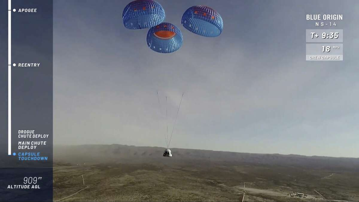 In this image from video made available by Blue Origin, the company's RSS First Step capsule uses parachutes for landing after a test flight in West Texas on Thursday, Jan. 14, 2021. (Blue Origin via AP)