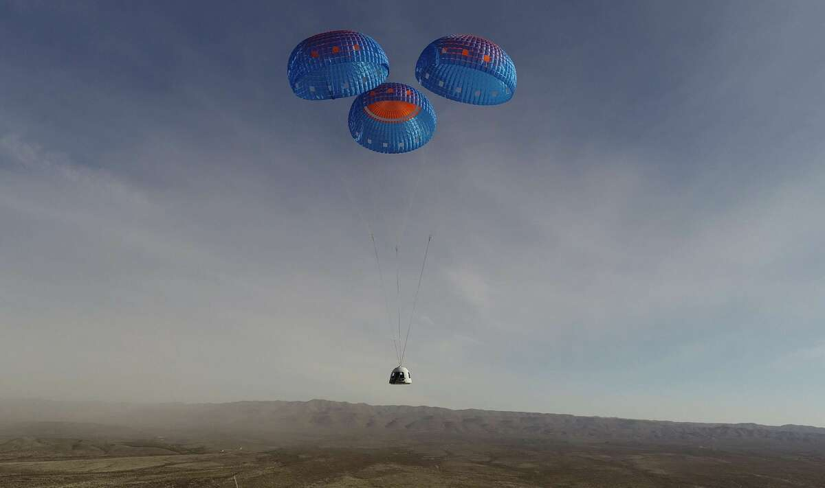 The crew capsule for Blue Origin's New Shepard suborbital rocket system uses parachutes to land in West Texas on Jan. 14, 2021. The capsule did not have people onboard.
