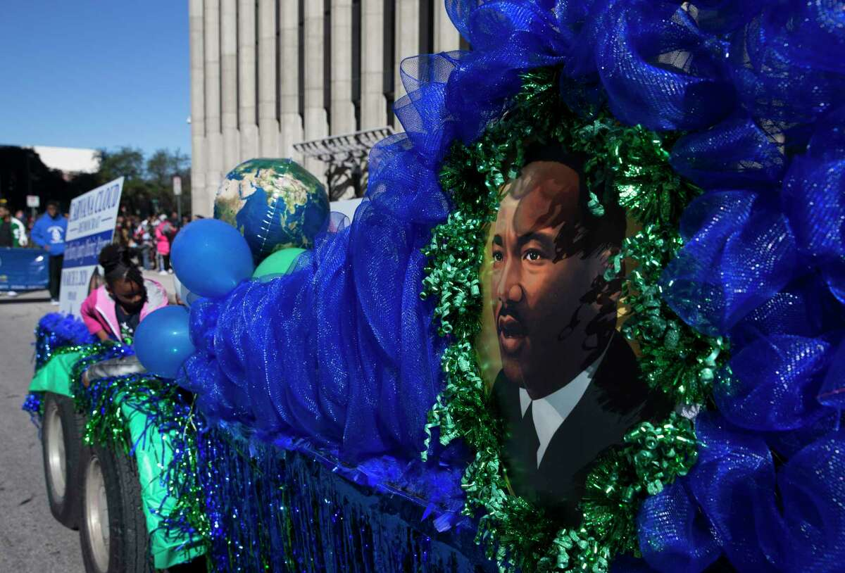 People celebrate Martin Luther King Jr. Day and watch the 42nd Annual Original MLK Day Parade Monday, Jan. 20, 2020, at downtown in Houston.