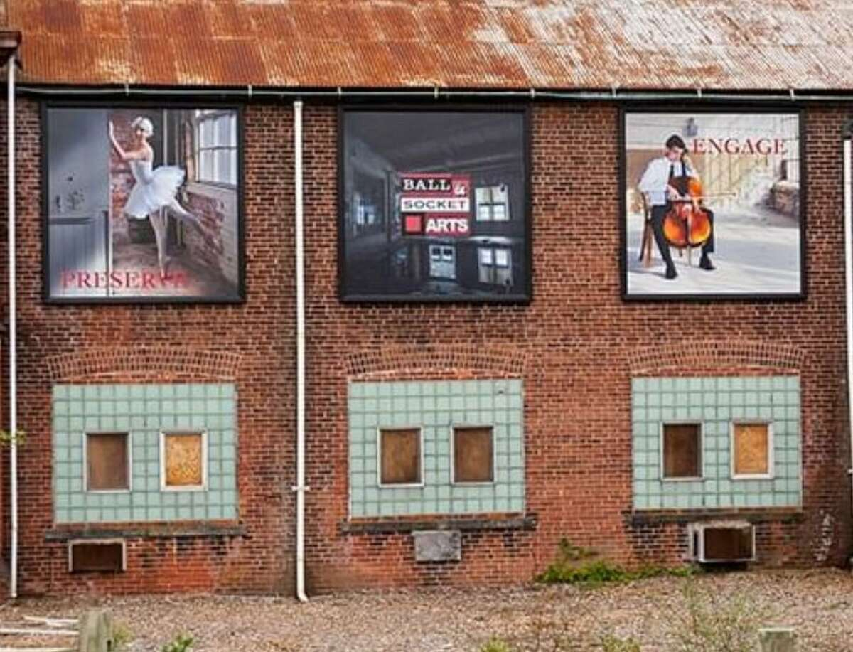 Artwork on the exterior of the former Ball & Socket manufacturing complex on West Main Street in Cheshire. A nonprofit is in the midst of turning the former factory complex into an arts center.