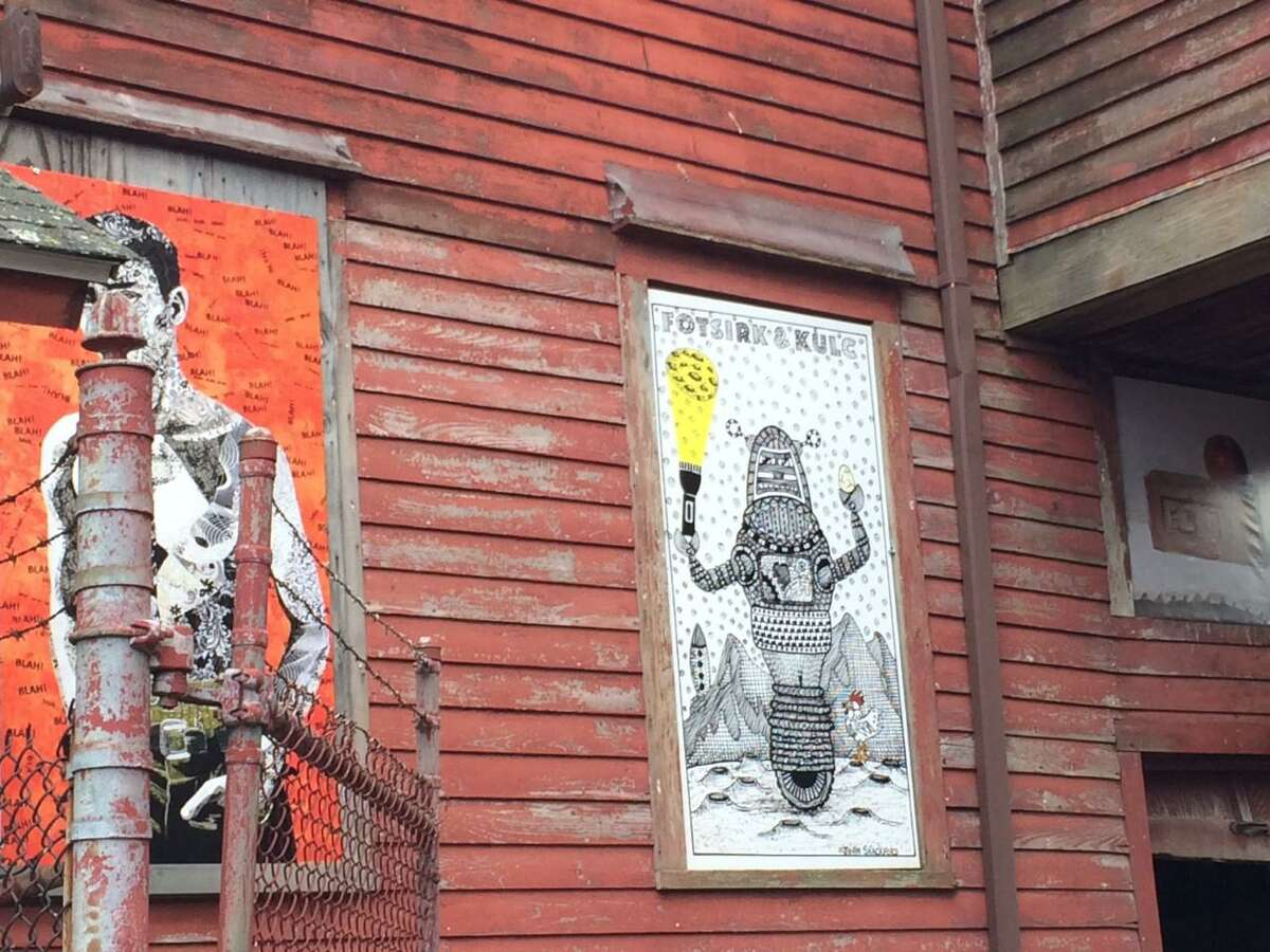 A July 2017 photo of artwork done on boarded-up windows at the former Ball & Socket manufacturing complex on West Main Street in Cheshire. A nonprofit is in the midst of turning the complex into an arts center that will include several commercial tenants.