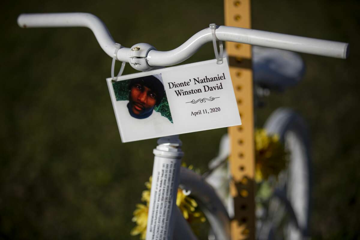 A ghost bike in memory of Dionte' Nathaniel Winston David sits at the corner of North Fry Road and Kieth Harrow Boulevard on Thursday, Jan. 14, 2021, in Katy.