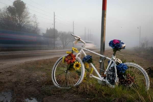 A ghost bike in memory of Henry Nikolai Benitez sits at the corner of FM 2218 and Koeblen Road on Thursday, Jan. 14, 2021, in Rosenberg.