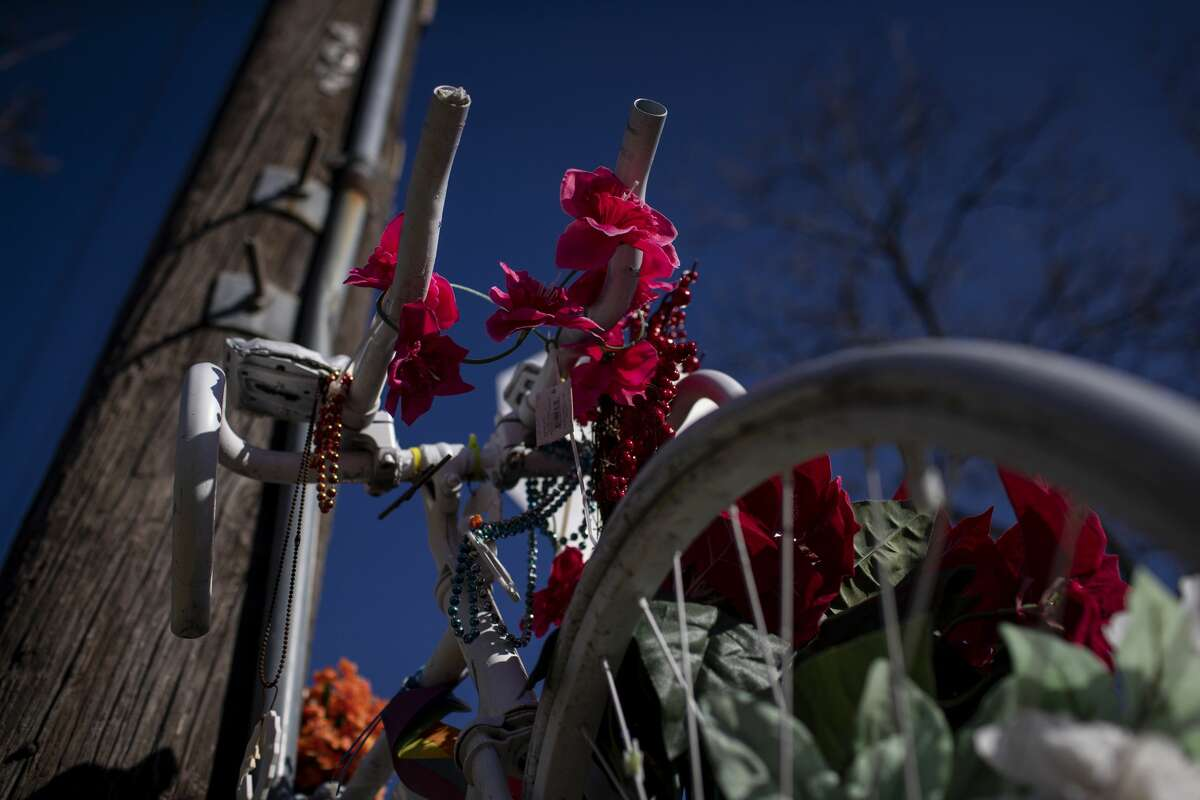 A ghost bike in memory of Mark Brooker sits at the corner of Oxford Street and East 38th Street on Thursday, Jan. 14, 2021, in Houston.