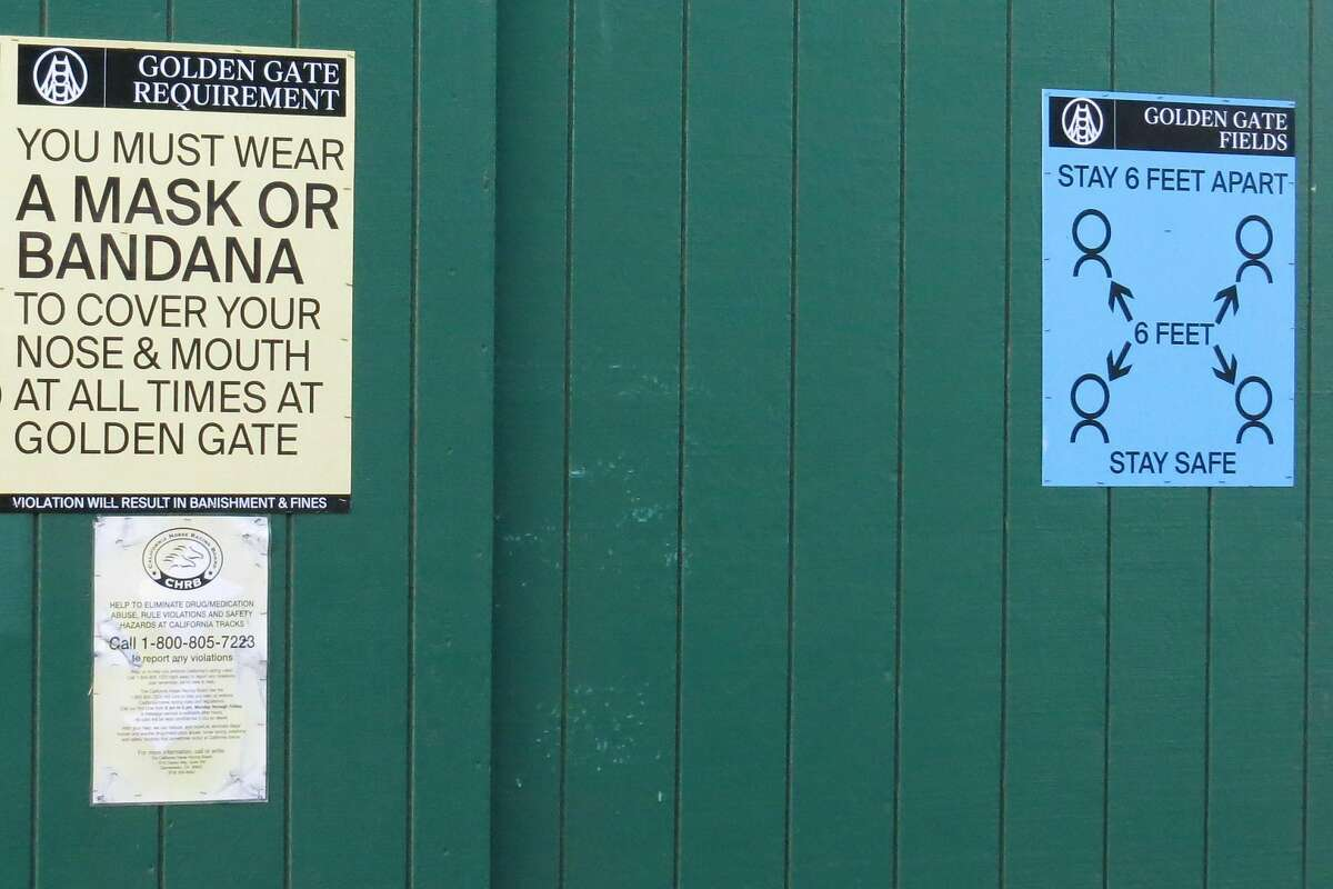 Golden Gate Fields posted signs reminding workers to wear a face covering, as mandated by Alameda County regulations. A coronavirus outbreak at the track led to more than 300 people testing positive.