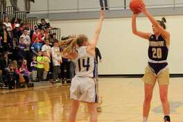 Reagan Thorr shoots a three-pointer against Onekama, less than an hour before she would tear her ACL going for a rebound against the Portagers on March. 6, 2020. (Record Patriot file photo)