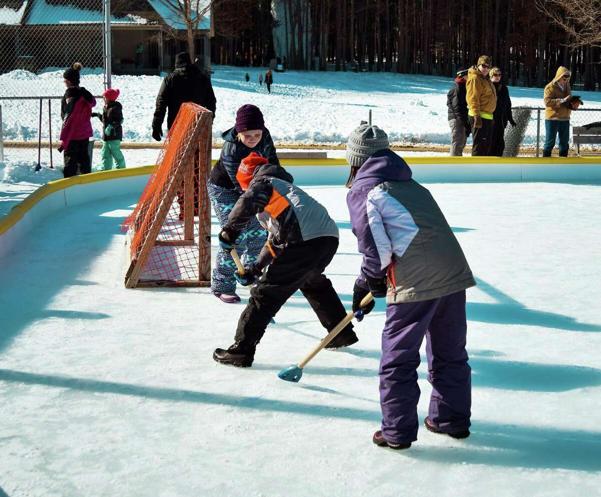 Guests at a previous Winterfest play hockey on one of CranHill Ranch's ice rinks. Ice skating also is one of the many activities offered during Winterfest. (Courtesy photo)