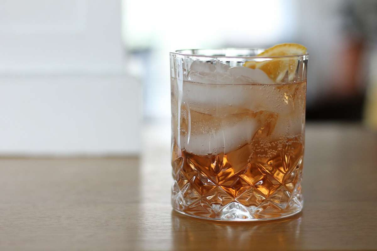 A faux Americano, made with Lyre's Aperitif Rosso and Italian Orange drinks, which approximate the flavors of red vermouth and Campari.