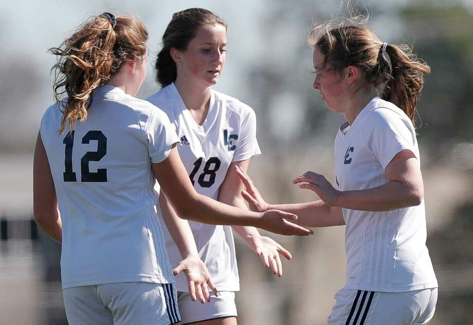 Lake Creek's Kate Coleman (12), Taylor Hampton (18) and Camryn Robbins (1) celebrate after Robbins' goal in the second period of a match during the Kat Cup girls soccer tournament at Berton A. Yates Stadium, Thursday, Jan. 14, 2021, in Willis. Photo: Jason Fochtman, Houston Chronicle / Staff Photographer / 2021 © Houston Chronicle