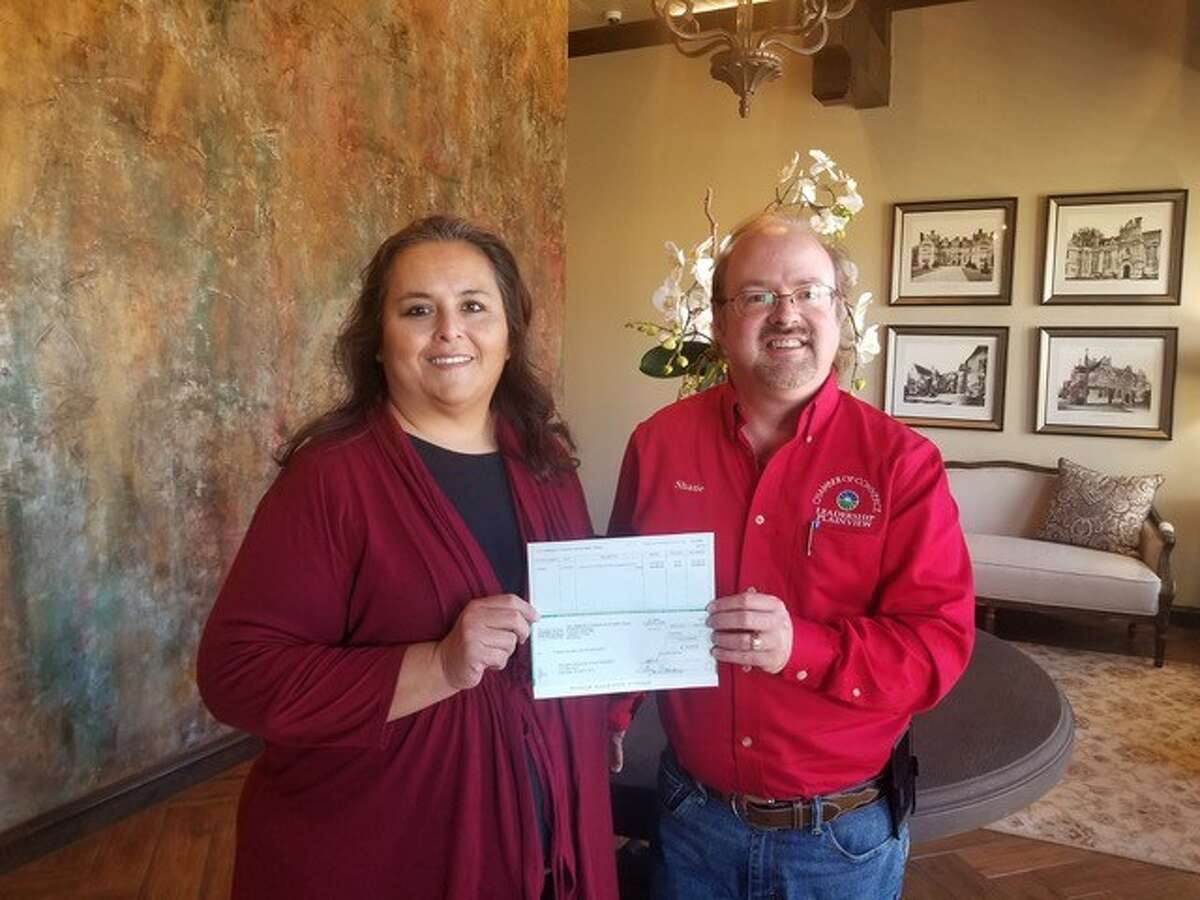 Denise Oviedo, director of grants and scholarships, presents a $20,000 grant award from the Community Foundation of West Texas to Shane Harrell, president of Plainview Community Concerts.
