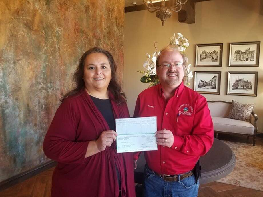 Denise Oviedo, director of grants and scholarships, presents a $20,000 grant award from the Community Foundation of West Texas to Shane Harrell, president of Plainview Community Concerts. Photo: Provided By PCC