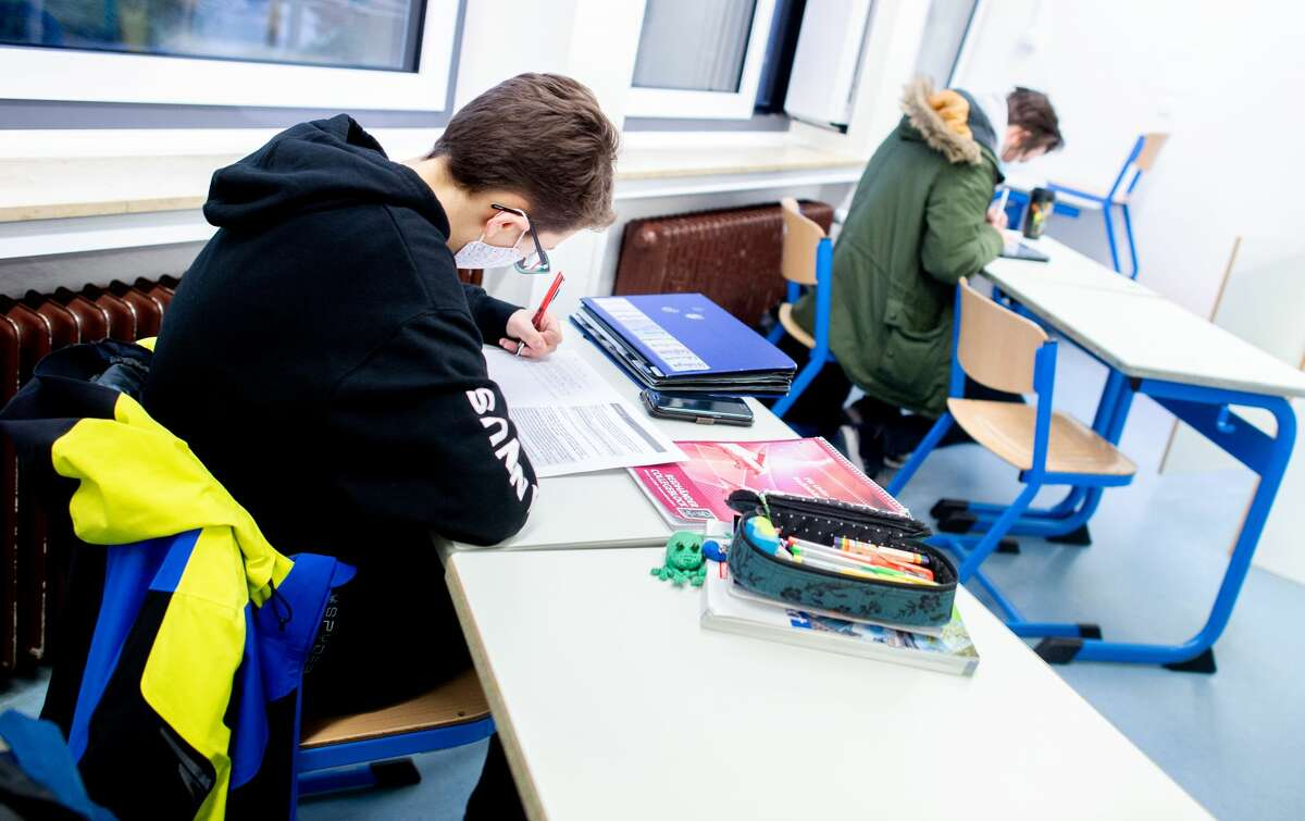 11 January 2021, Lower Saxony, Oldenburg: Students of a divided course of the upper school sit in a classroom of the Graf-Anton-Günther-Schule and work on an assignment.(Photo by Hauke-Christian Dittrich/picture alliance via Getty Images)