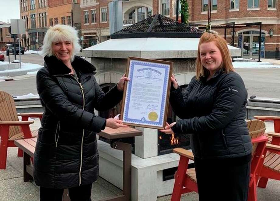 Rep. Annette Glenn (left) presents a special tribute to Carly Lillard with the Midland Rotary Club. (Photo Provided)