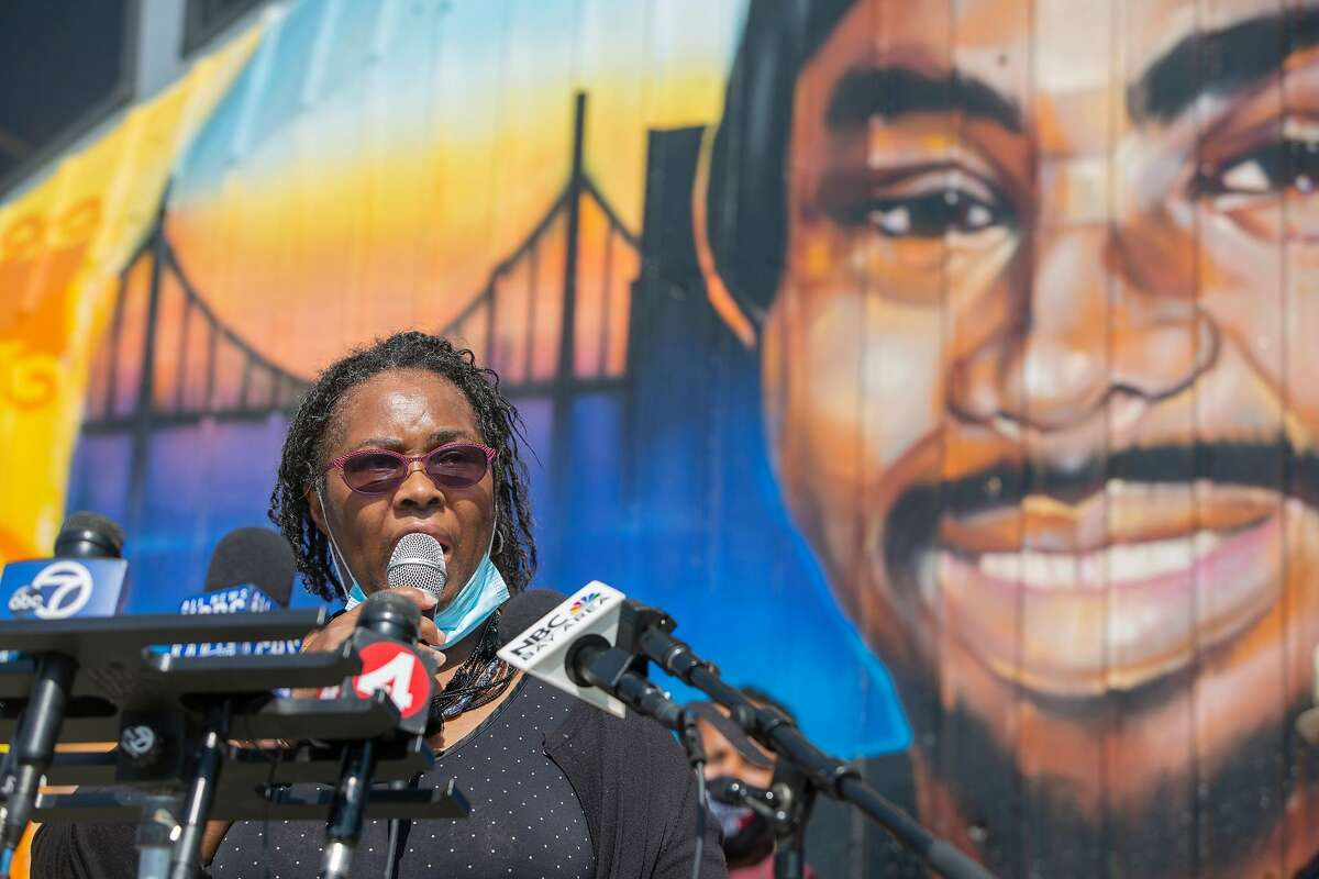 Wanda Johnson, Oscar Grant's mother, urged BART directors Thursday to imagine their child, face pressed into cold cement, pleading they can't breathe before being shot and dying, bleeding from the mouth.
