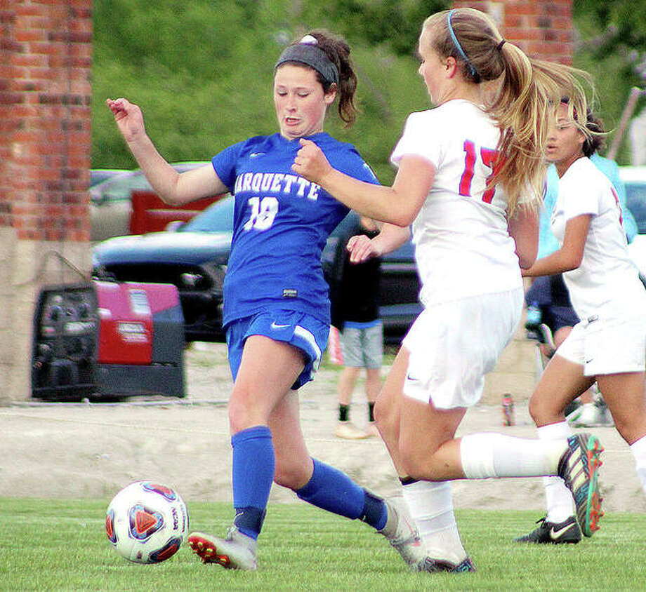 Madelyn Smith of Marquette (18) has announced that she will play soccer next season for Saint Louis University. Above, Smith moves the ball while being marked by Olivia Mouser of Roxana during a 2019 Class 1A regional game. Photo: Pete Hayes | The Telegraph