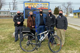 Madison County Transit has donated iForce police bicycles to the Troy and South Roxana Police Departments. Pictured at the South Roxana Village Hall are, from left, South Roxana Police Lt. Brian Doyle, South Roxana Mayor Barb Overton, South Roxana Police Chief Bob Coles, MCT Managing Director SJ Morrison and MCT GIS Specialist David Cobb.