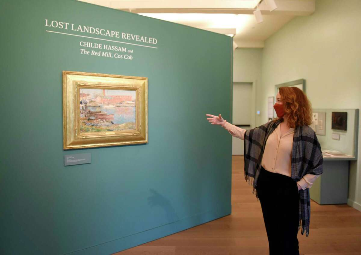Curator of Exhibition and Collections Maggie Dimock points out Childe Hassam's 1896 painting