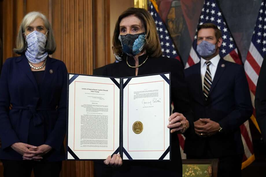 House Speaker Nancy Pelosi of Calif., displays the signed article of impeachment against President Donald Trump in an engrossment ceremony before transmission to the Senate for trial on Capitol Hill, in Washington, Wednesday, Jan. 13, 2021. (AP Photo/Alex Brandon) Photo: Alex Brandon/AP / Copyright 2021 The Associated Press. All rights reserved.