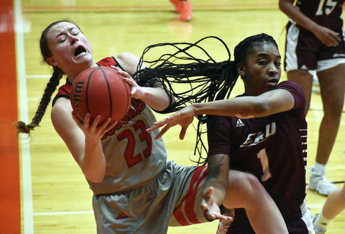 SIUE senior forward Allie Troeckler, left, fights for a rebound in the fourth quarter of Thursday's game against Eastern Kentucky University inside First Community Arena.