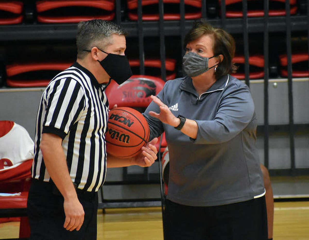 SIUE coach Paula Buscher, right, talks to an official about a call in the third quarter of Thursday's game against Eastern Kentucky University.