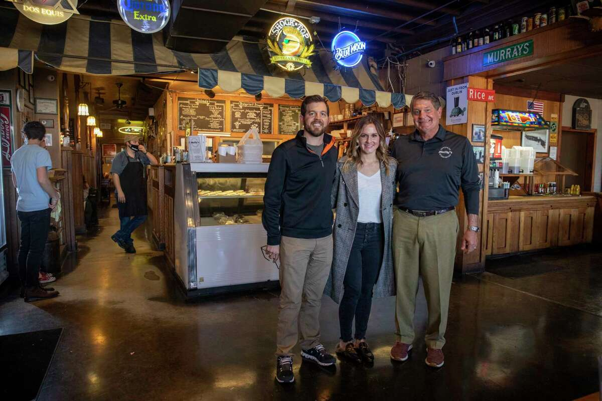 New owners Neil Dufford, Betsy Wells and Scott Dufford pose for a portrait Thursday, Jan. 14, 2021 at Murray's Deli. Jacy Lewis/Reporter-Telegram
