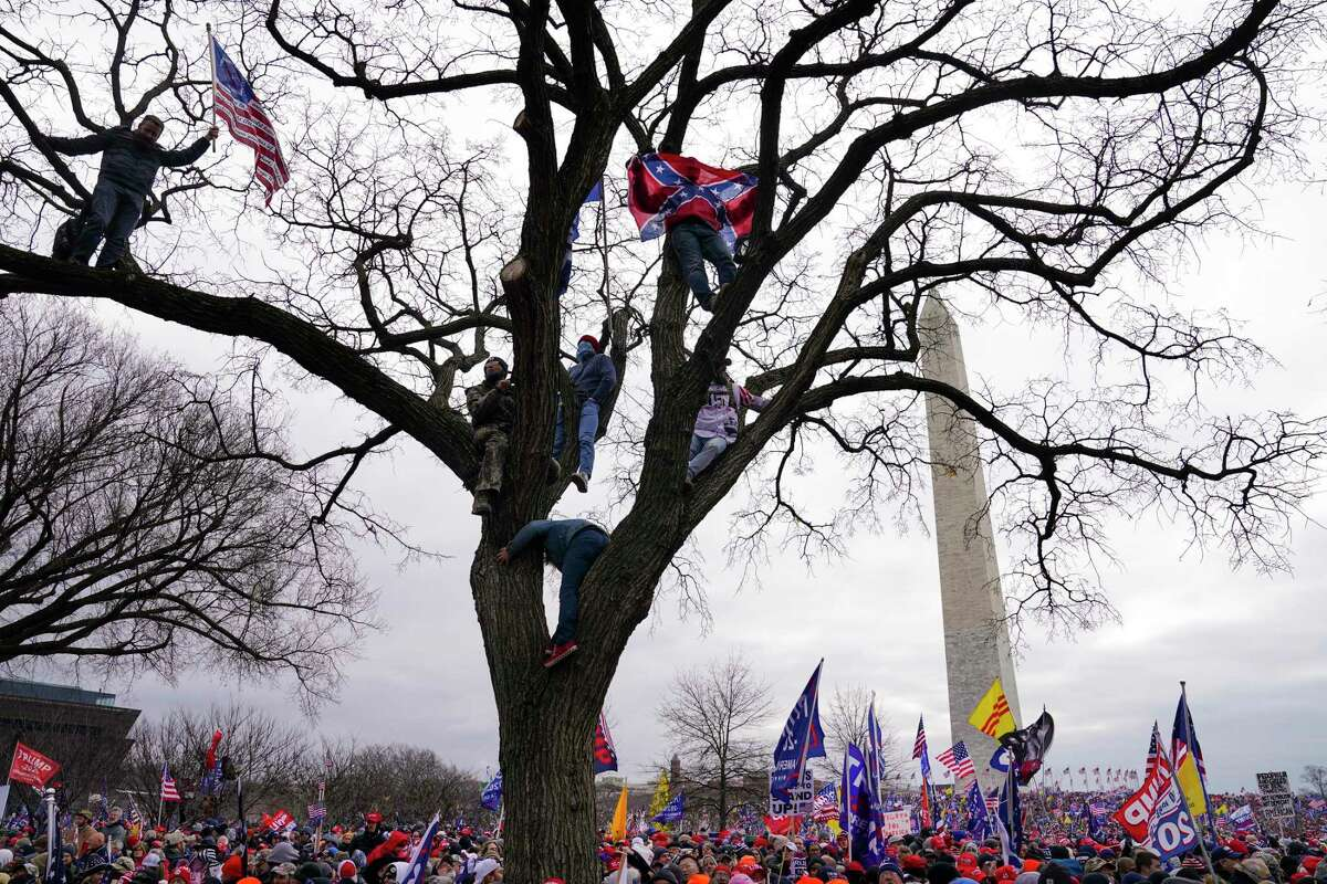 FILE - In this Wednesday, Jan. 6, 2021 file photo, supporters of President Donald Trump participate in a rally in Washington. (AP Photo/John Minchillo)