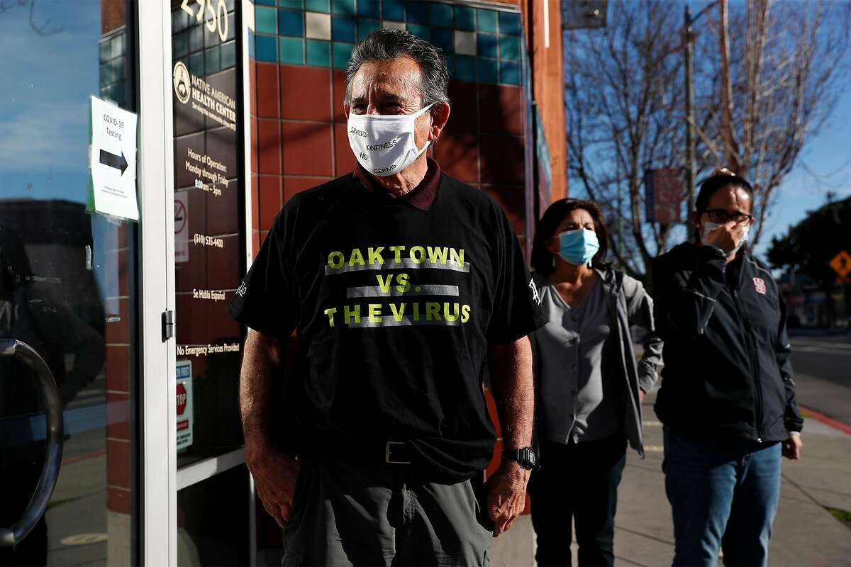 Oakland Councilman Noel Gallo waits in line to receive the Moderna COVID-19 vaccine shot at Native American Health Center in Oakland, Calif., on Thursday, January 14, 2021.