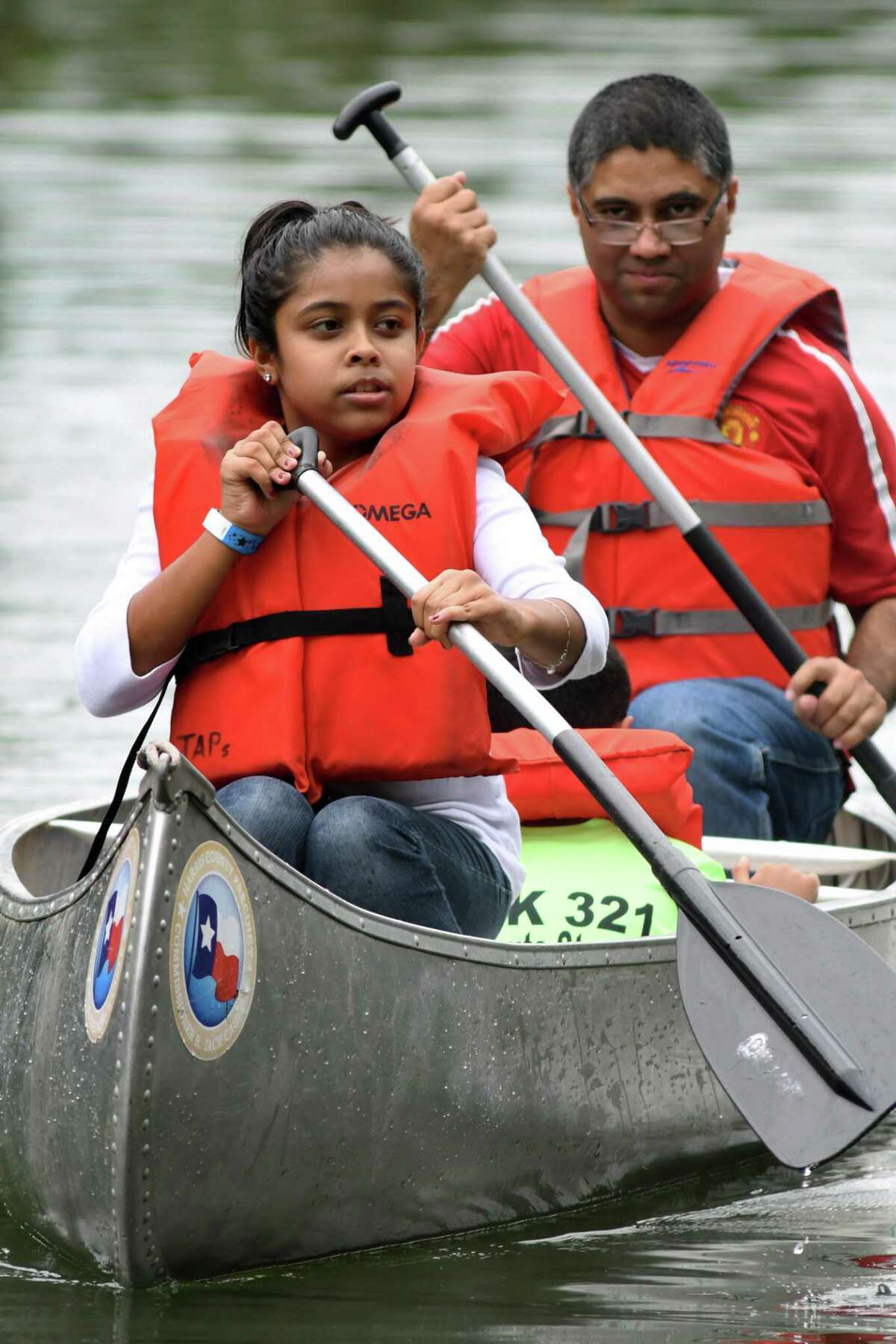 Harris County Pct. 4 will host a canoeing adventure at Burroughs Park in Tomball on Jan. 28. Shown here: Soha Siddiq, 11, left, a 6th grader at Schindewolf Middle School, her dad Omer, of Spring, and brother Zain (hidden), 7, a 2nd grader at Mueller Elem., canoe their way across Marshall Lake during the first Harris County Precinct 4 Civic Adventure Day held at Kickerillo-Mischer Preserve in the Cypress Creek area on Sept. 29, 2018.