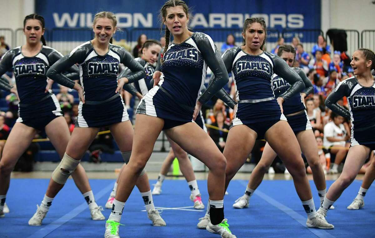 Avery Wallace and the Staples High School cheerleading squad competes during the FCIAC cheerleading championships at Wilton High School in Wilton, Conn., on Feb. 8, 2020.