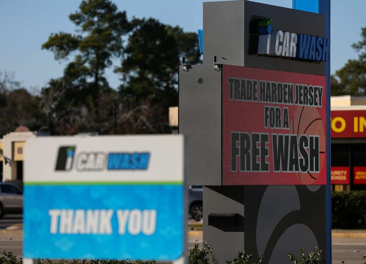 Following the James Harden trade, a car wash on FM 1960 offers to trade a Harden jersey for a free car wash Wednesday, Jan. 14, 2021, in Houston. Sean Qureshi, iCarwash owner and a Houston Rockets fan, said he was bummed by the trade and wanted to make people laugh.