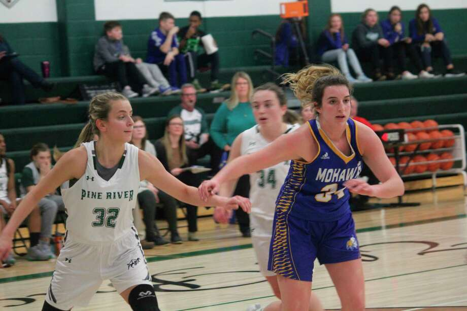 Brooke Brauher (right) of Morley Stanwood was the 2019-20 Pioneer Dream Team player of the year. (Pioneer file photo)