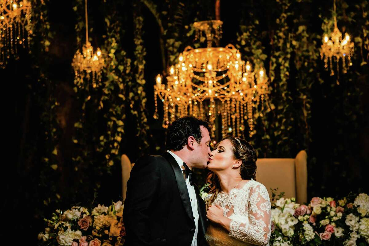 Sara Padua and David Cordúa tie the knot in Cuernavaca, Mexico. The newlyweds danced under a black tent lined with chandeliers during their wedding reception.