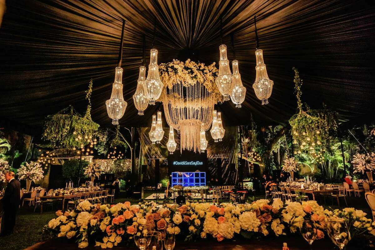 """Sara Padua and David Cordúa tie the knot in Cuernavaca, Mexico at Hacienda de Cortés, where conquistador Hernán Cortés wed a woman of Aztec ancestry; their son, Martín Cortés, was one of the first known mestizos of New Spain. """"Plus, the place looks like something out of 'Lord of the Rings,'"""" the grooms says. """"It's a secret garden, and everything seems kind of alive."""""""